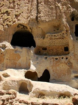 """Bandelier National Monument - Magma Cum Laude - AGU Blogosphere. """"Many of the cliff dwellings used to have structures built in front of them, leaving the caves as back rooms.  Holes for the ceiling poles are still visible in the tuff, which is relatively soft and quite easy to hollow out."""""""