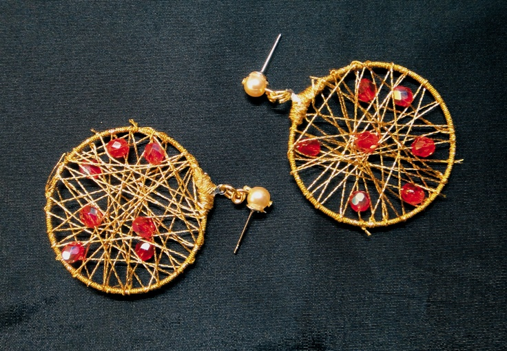 handmade earings made of hard thread and red pearls