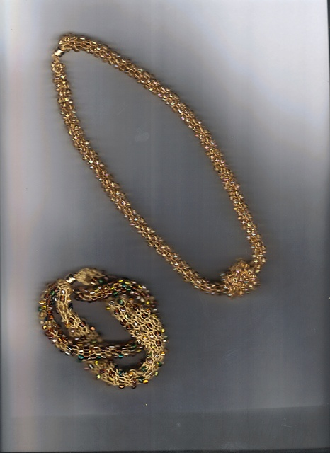 More knitted jewelry with beads. I think it's made as a knitted tube?