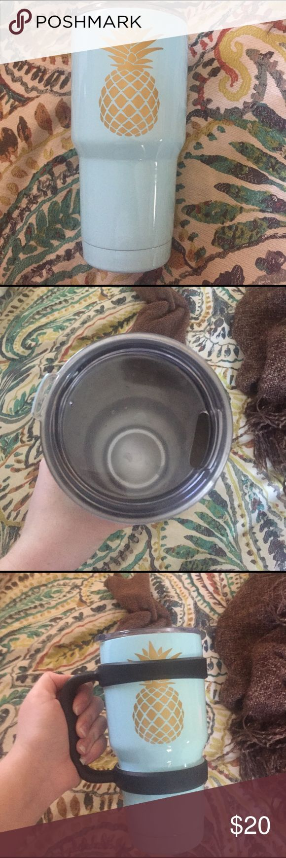 Tumbler This is not a yeti tumbler. It is a look alike. Dipped baby blue with a Pineapple monogram. Almost brand new- used twice. Comes with Handel also. Accessories