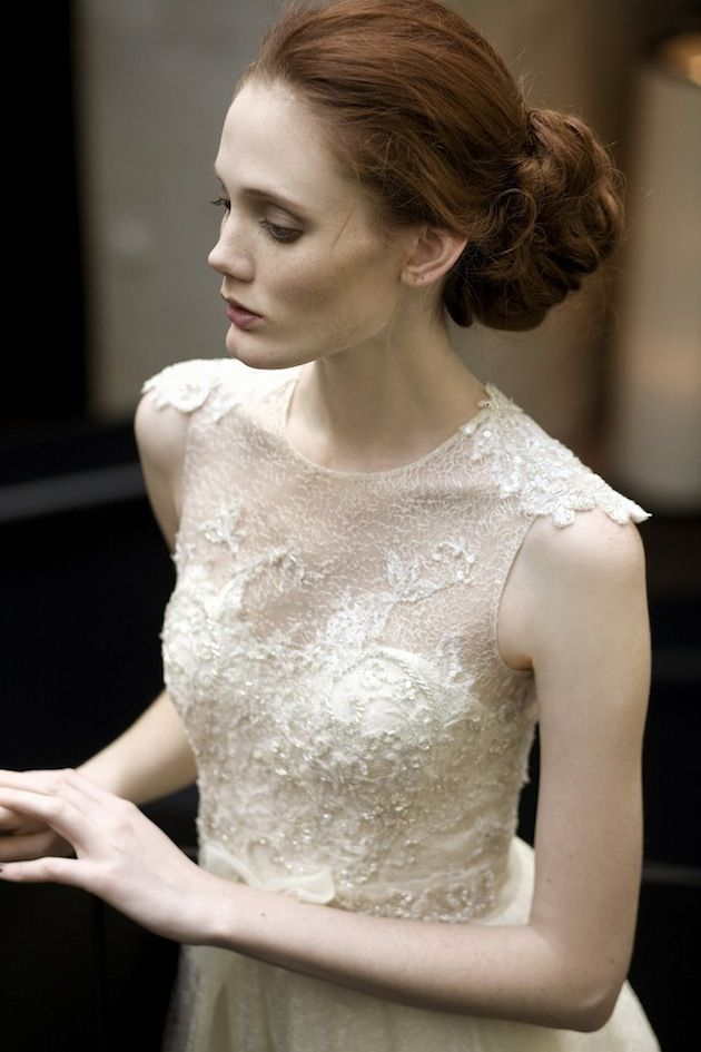 bun and beautiful lace wedding dress