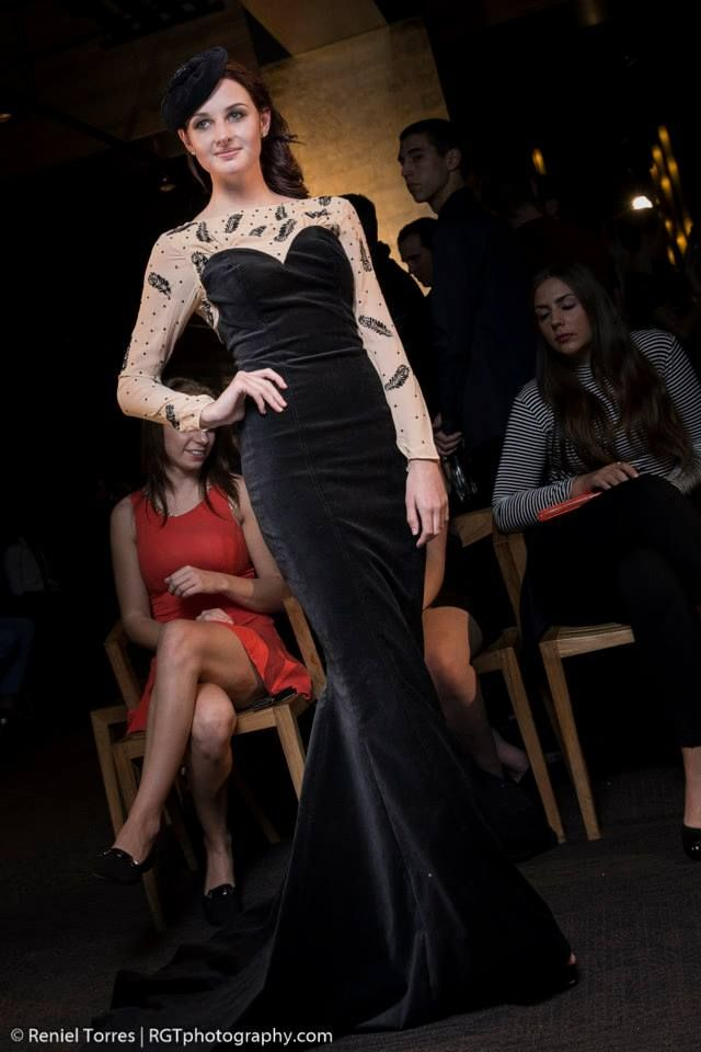 Maîtresse Gown- Nude silk-georgette décolletage and sheer long sleeves with silk button cuff closure. Featuring flocked black peacock feather and jet Swarovski crystal embellishment. A fully lined soft noir velvet gown with dramatic fluted train