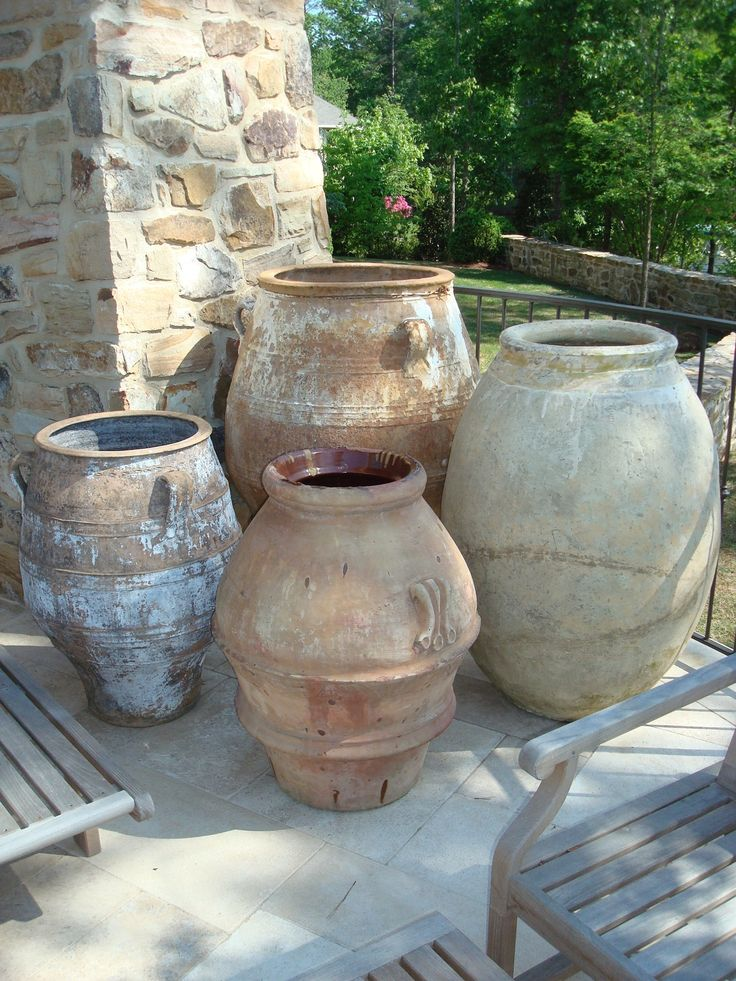 love the different sizes of planters grouped together