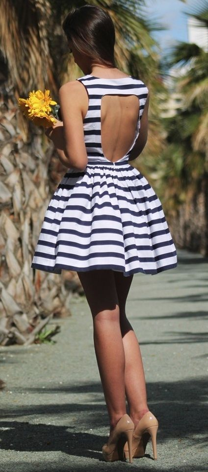 Striped flare dress with an open back and nude pumps. love!
