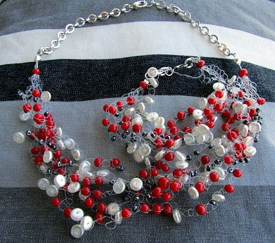 red white and grey nylon necklace