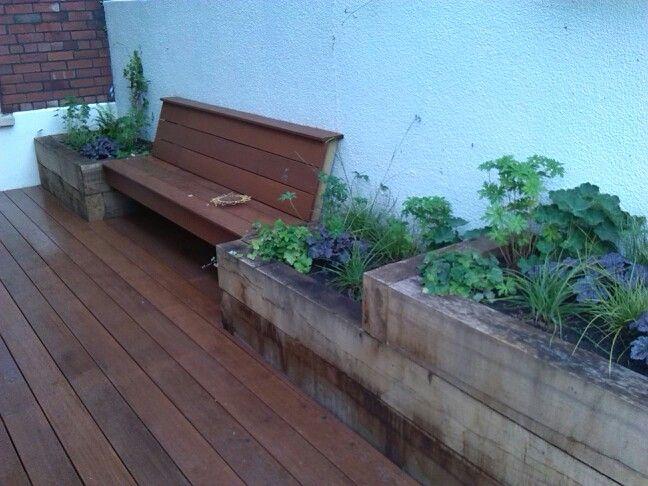 Hardwood deck with oak sleeper raised beds.