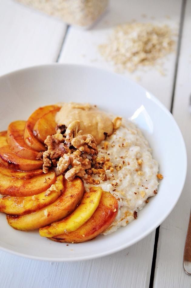 Creamy Oats with Cinnamon Fried Apple and Mango Slices and Peanut Butter and Roasted Walnuts | Source: gastronomicgoodies, via peone