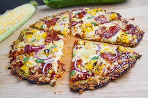Zucchini Pizza Crust (with Chipotle BBQ Bacon and Grilled Corn Pizza)  [Crust: 4 cups zucchini, shredded 1/2 cup mozzarella, shredded 1/4 cup parmigiano reggiano (parmesan), grated 1 egg 1 teaspoon oregano or Italian seasoning salt and pepper to taste [I'd add some coconut flour and a bit of flaxseed meal for substance]]