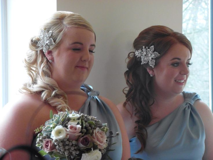 Bridesmaids hair curled with curlstick and swept to the side