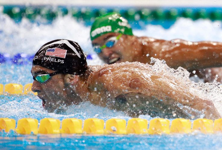 Michael Phelps (L) of the United States leads Chad le Clos of South Africa in the Men's 200m Butterfly Final at the Rio 2016 Olympic Games on August 9, 2016 in Rio de Janeiro, Brazil.