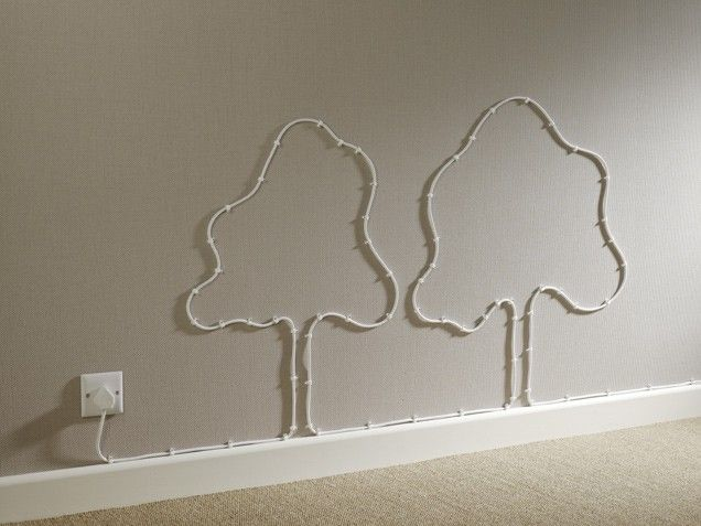 Get Creative If cables have to be in plain sight, get creative and tack them to the wall in a fun pattern.