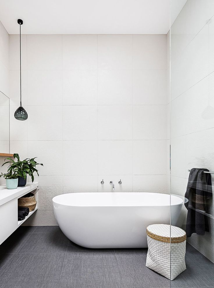 """Rachel and Marty's modern-classic Victorian cottage renovation:The spacious bathroom has a large bath from [Bathroom Warehouse](https://bathroomwarehouse.com.au/