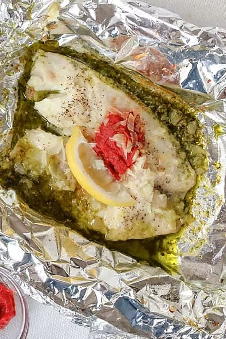 Let the slow cooker do the work for your dinner tonight. Flaky white fish fillets are bathed in a rich homemade pesto and topped with a smattering of smooth tomato paste accompanied by a tart lemon wedge in these Tilapia and Pesto Foil Packets.