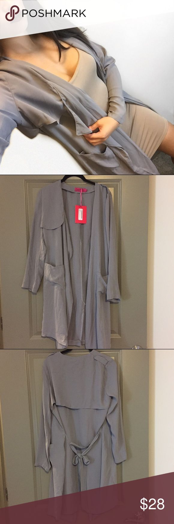 NWT Waterfall Trench Duster Jacket BooHoo Waterfall Trench/Duster Jacket. Light grayish purple color. Size US 6. Has a belt that you can also detach. Brand new, never worn, tags still attached. Just haven't worn it yet so am selling it for what I paid. Perfect condition. Boohoo Jackets & Coats Trench Coats