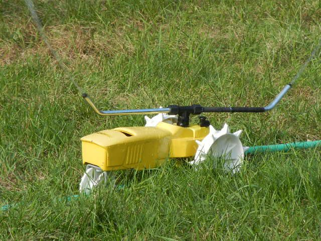 lawn tractor sprinkler | ... Raintrain Traveling Lawn Tractor Sprinkler Walking Three Speed   I love mine