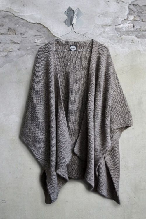 This is a great piece for layering - when cold weather hits. I would wear a black cashmere turtleneck under it.