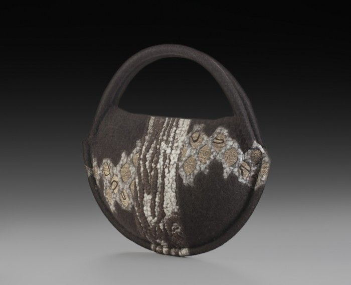 Black Canteen, HB136 2013 13″ x 13″ x 3.5″ Finn wool fiber, waxed linen and cotton thread, plastic tubing, magnets; wet felting (partial felt surface patterning), free-motion machine embroidered surface embossing, hand stitched construction, shellac stiffened photo credit: Mary Vogel sold
