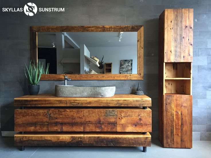 Beautiful recycled wood vanity. Custom made. Storage column can be custom made as well. Create the bathroom of your dreams.