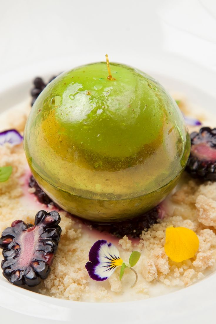 A gourmet spin on apple and blackberry crumble, Aaron Patterson's signature Granny Smith dessert contains all the elements you'd expect – including boozy fruit compote and golden crumble – with half of the dessert served inside an impressive sugar dome.