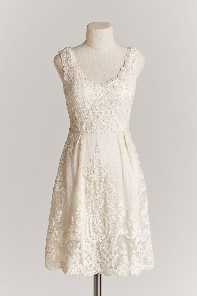 Chic, Sophisticated Wedding Dresses for Romantics: The Alexandra gown's short flared skirt and scalloped edges at the neckline and hem, with vine embroidery, French knots and lovely sheer straps  http://www.confettidaydreams.com/chic-sophisticated-wedding-dresses/