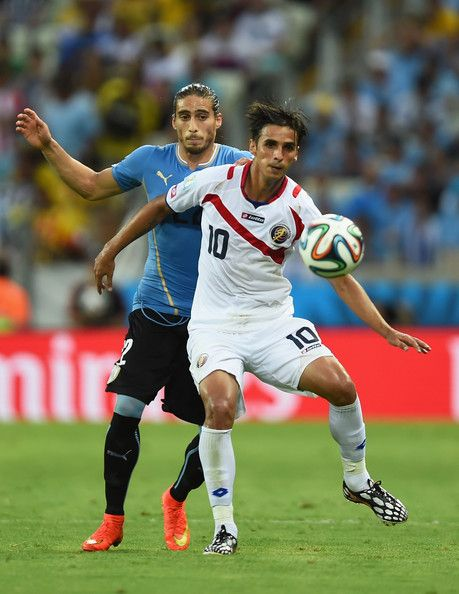Bryan Ruiz of Costa Rica against Martin Caceres of Uruguay in the 2014 World Cup