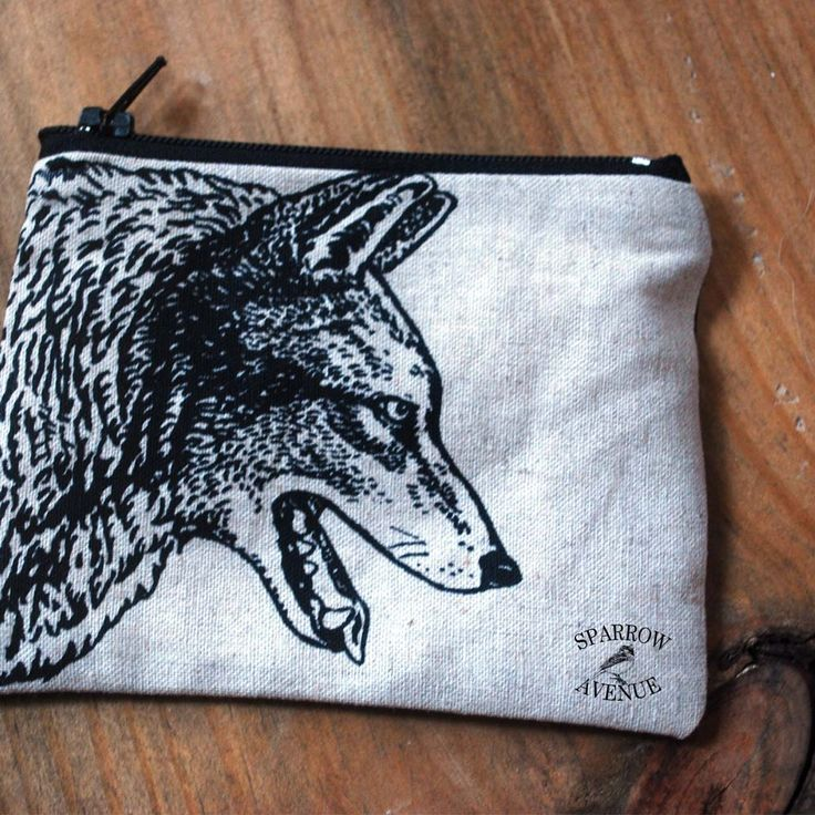 my original drawing of a wolf that I've printed onto a small coin pouch.