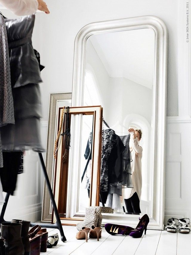 Open closet with mirrors and a rolling rack