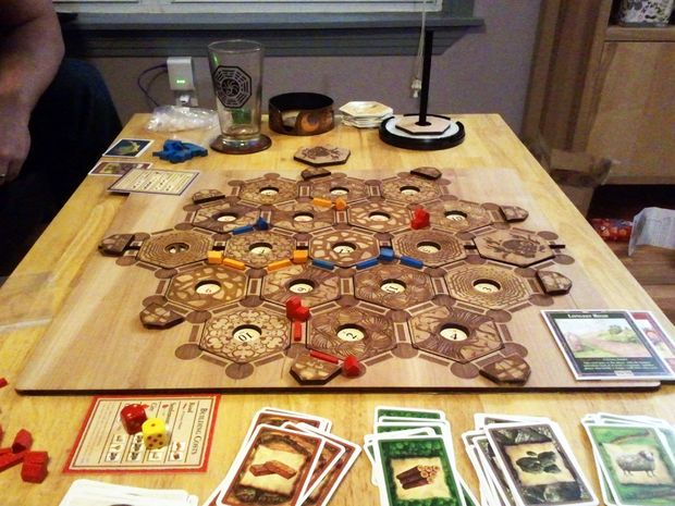 """I discovered this custom designed Settlers of Catan board on Kickstarter last year and knew I needed to support the project! For a donation, I got the files to assemble something I could laser cut on our Epilog. After arranging the files how I wanted (and creating a custom desert tile), I cut, sanded, and finished the piece in 1/4"""" pine. Then I backed the board with some awesome leather I found, using contact cement. If I were to do this again, I wo..."""
