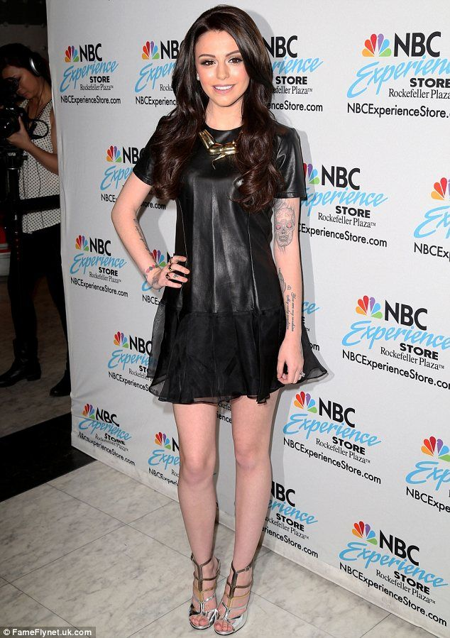 Brunette ambition: Cher Lloyd was promoting her new album in New York on Tuesday after dye...