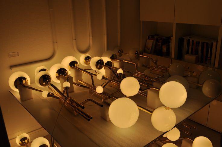 """Applique - Restaurant """"Au Boeuf couronné"""" Tube laiton cintré / boule de verre / coupelle laiton / Led /    Design : Fabrice Ausset  Conception et Réalisation : Astropol"""
