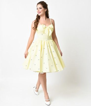 Shine a light, dames! The Golightly dress is a picturesque 1950s inspired swing in a soft yellow and white polka dot cot...Price - $98.00-IHb7NRq1