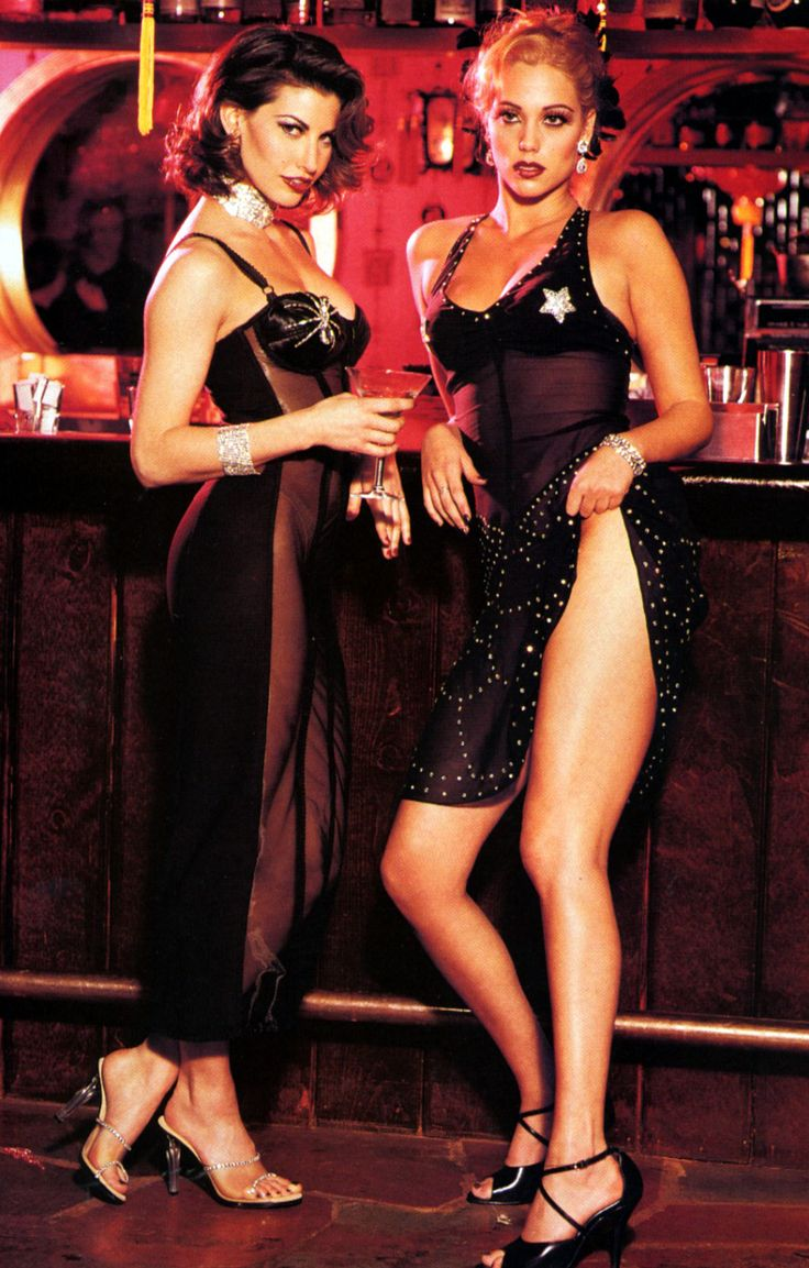 Gina Gershon and Elizabeth Berkley as Cristal Connors and Nomi Malone in Showgirls.