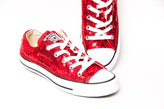 Hand sequined just for you with loads of bright shiny red sequins securely attached to a pair of genuine Converse® and finished off with matching red glitter piping for a fantastic look of sparkle and shine!  • Made to order  • True to size Sizing Note: When selecting your size, please select the Womens size. For example, a Mens size (that appears on the bottom of the shoe) 6 = a Womens size 8.  Ships in approximately 14 days. Need them sooner? Just add this to your order: https:/&...