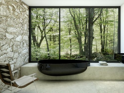 Beyond Bath by Claudia Danelon | Black tub with stone forest
