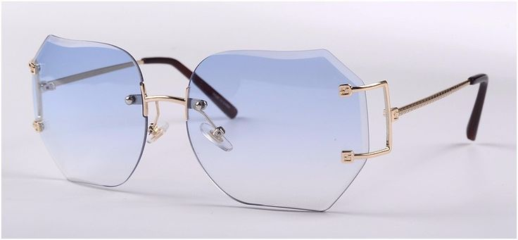 Gorgeous gold 1980s vintage rimless octagon shaped sunglass. These elegant beauties have a stunning bridge design adding to their appeal. Lightweight and comfortable for wearing all day long. Finished