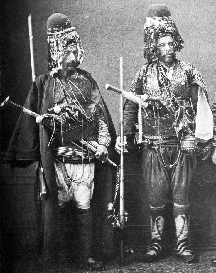 Zeybeks (Zeibek / Ziebek), were irregular militia and guerrilla fighters living in the Aegean Region of the Ottoman Empire from late 17th to early 20th centuries. (Note the extremely long, T handled yatagan swords both men carry). Les costumes populaires de la Turquie en 1873.