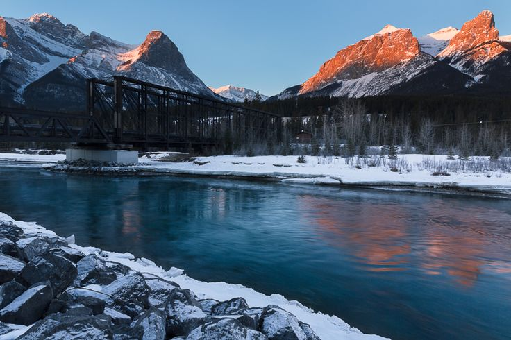 Daylight breaks throught the mountains in Canmore, Alberta #Canmore