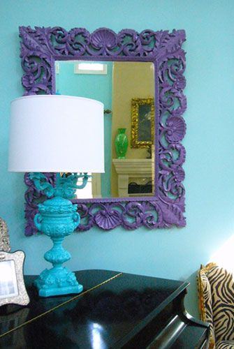 love the idea of a purple framed mirror. plus all these colors, patterns, and textures are mixing well.