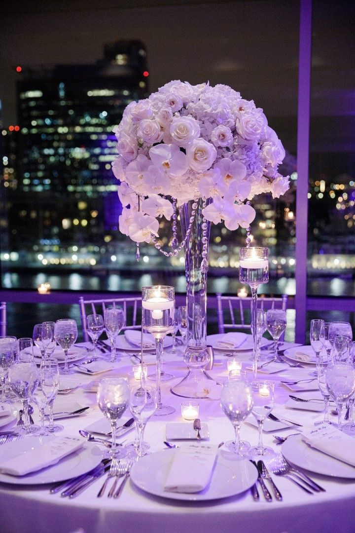 Breathtaking New Jersey Wedding - MODweddinglove the two taller vases with votives/floating candles with the tall centerpieces