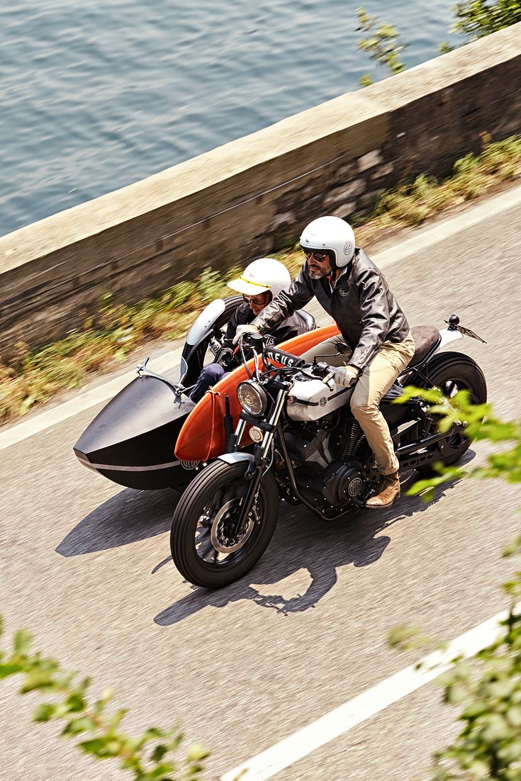 Fancy a bit on the side? Here's the latest from custom builder Deus Italy, a Yamaha XV950 with a super-stylish sidecar—and a surfboard rack too. We're smitten.