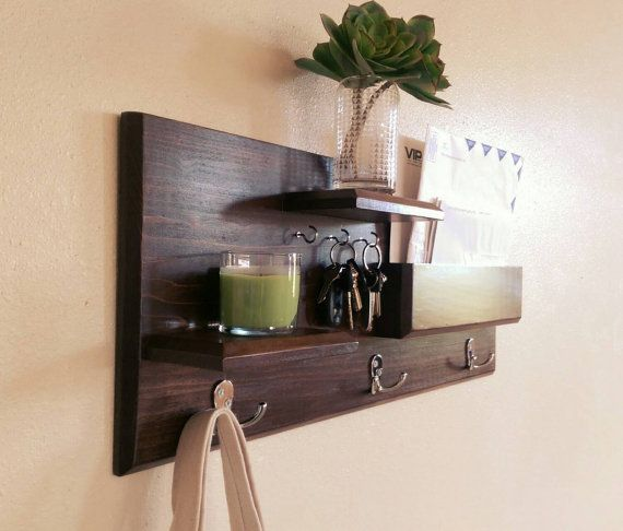 Keep your home stylishly organized with this Midnight Woodworks original design. Our handcrafted shelf and hook entryway organizer is an