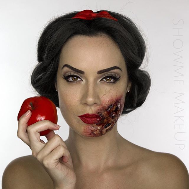 "Pin for Later: Disney Princesses Reimagined For Halloween Will Give You Nightmares Snow White ""The Evil Queen's poisoned apple has caused a severe chemical burn to poor Snow's face!"""