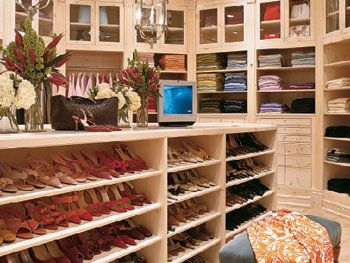 Nate Berkus designed Oprah's closet.  I love the way her shoes are ordered by color, and her bag storage