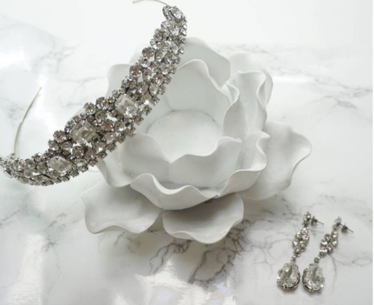 A sparkly hairpiece and matching Erica Koesler earrings for your beautiful wedding day look! See more here: http://www.ericakoesler.com/product-category/hair-accessories/