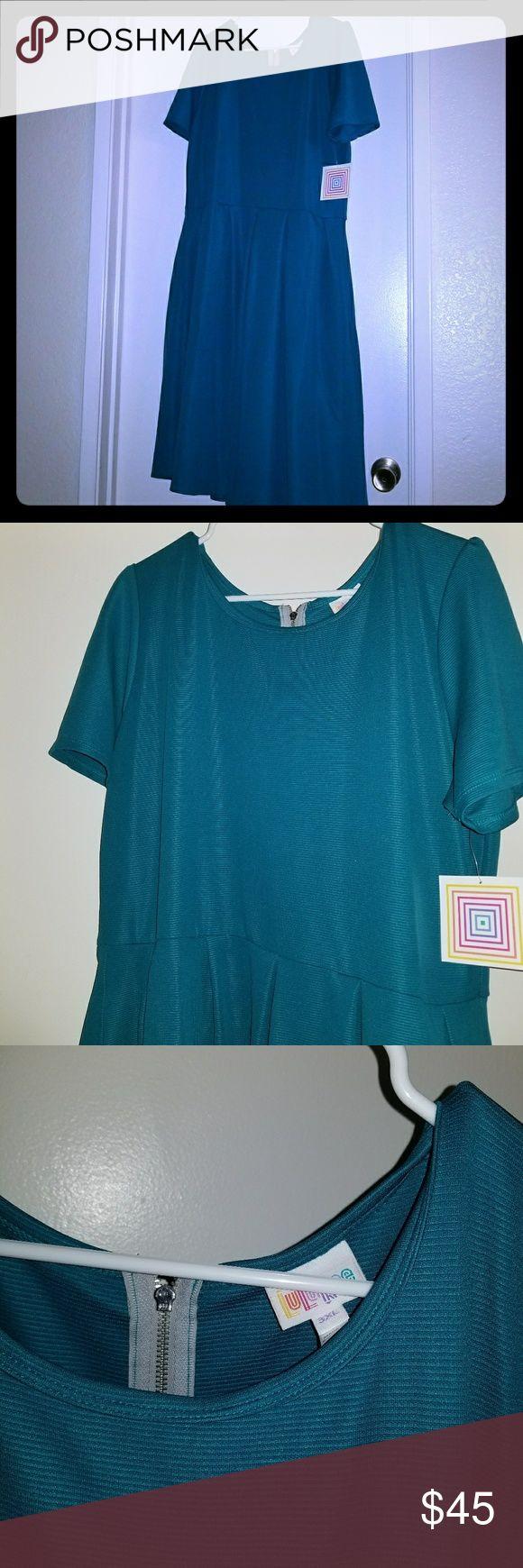 Lularoe Amelia New with tags, solid turquoise color. Pockets! LuLaRoe Dresses