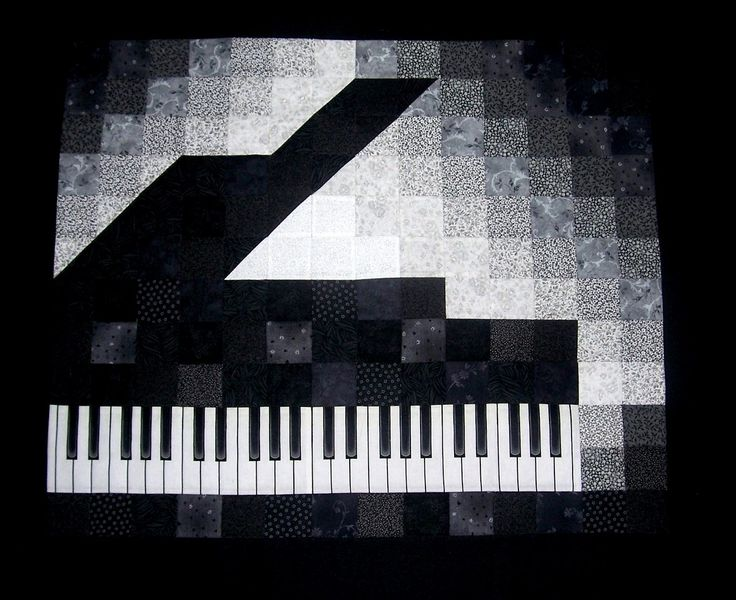Piano Keyboard quilt top. Could be done in black and white charm squares. White keys on keyboard are separated with black line embroidery. Black keys look like they're appliqued.