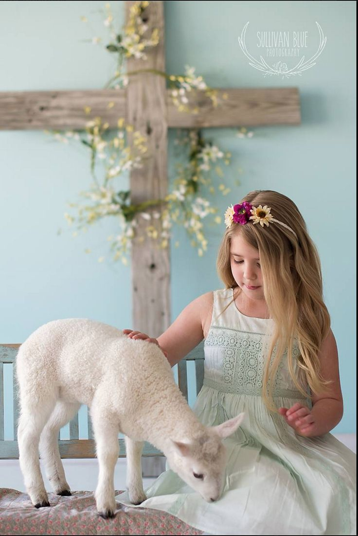 Easter mini session set up Wooden cross pretty floral garland and live lamb from  Sullivan Blue
