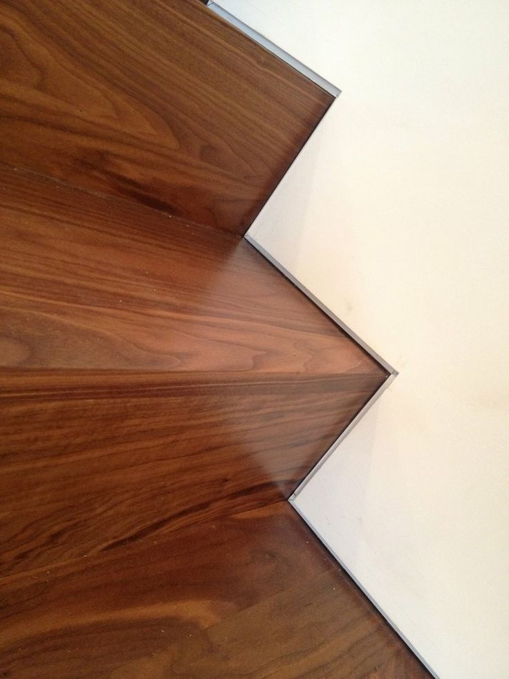 Custom walnut stairs with the use of a Fry drywall reglet providing a 12 reveal consistent to