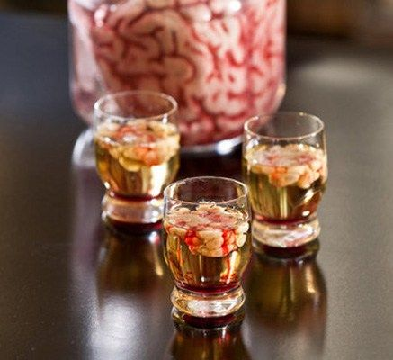 The Bloody Brain Halloween Shot  The Bloody Brain - mix 1 1/4 oz vodka and 1/8 oz lime juice and add to shot glasses to fill to about 3/4 full. Slowly add cream liquor to form brain. Drizzle grenadine.