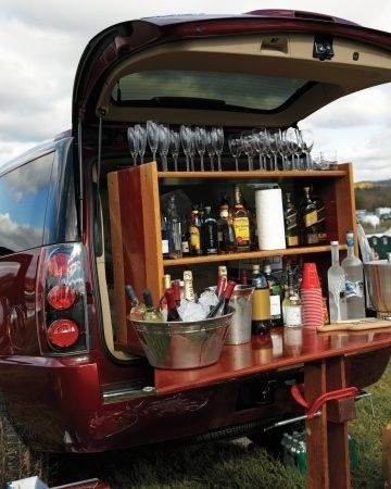 Convert the back of your car into a fully-stocked bar with a set of shelves. Love this!